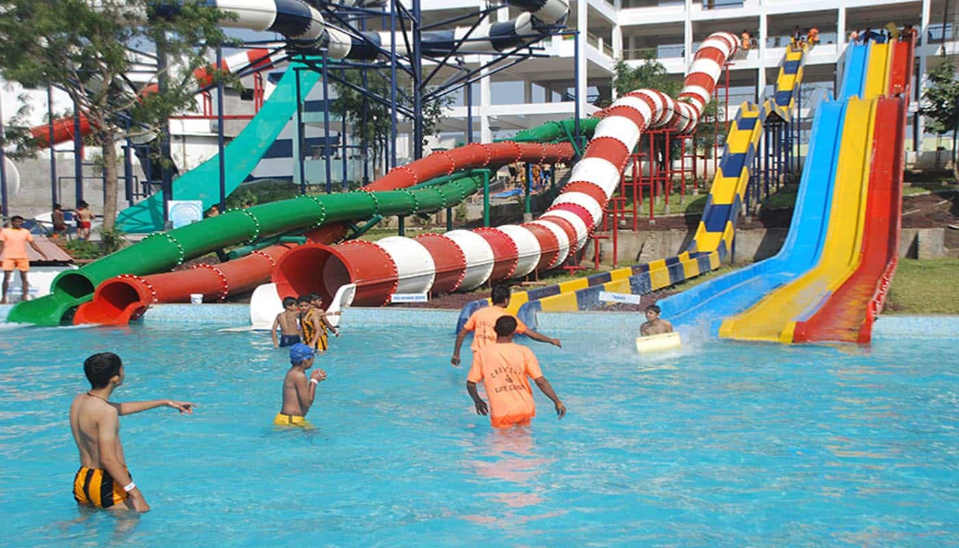 waterpark A water park (occasionally written as waterpark) is an amusement park that features water play areas, such as water slides, splash pads, spraygrounds (water playgrounds), lazy rivers, or other recreational bathing, swimming, and barefooting environments.